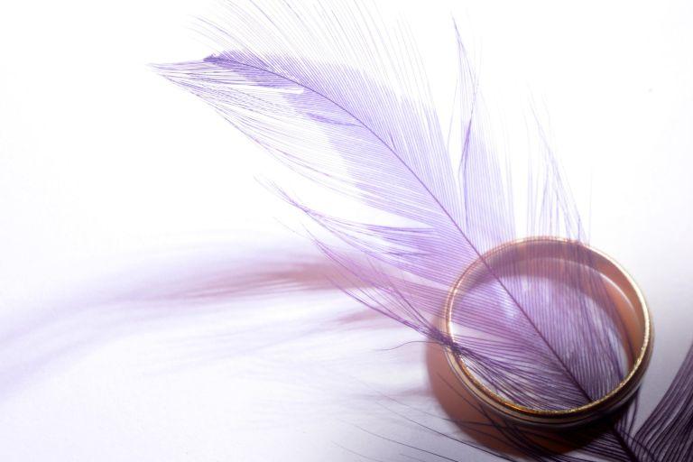 wedding ring feathers closeup