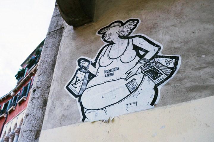 """Satirical """"Venezia Land"""" street art in central Venezia."""