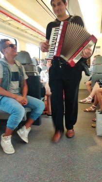 A musician coming into the train to Barcelona to play as we ride