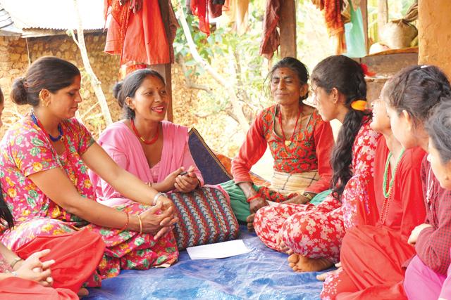 SUPPORT SYSTEM: Social mobiliser Geeta Basnet (second from left) talks to women in Bhattagaun, Nuwakot.