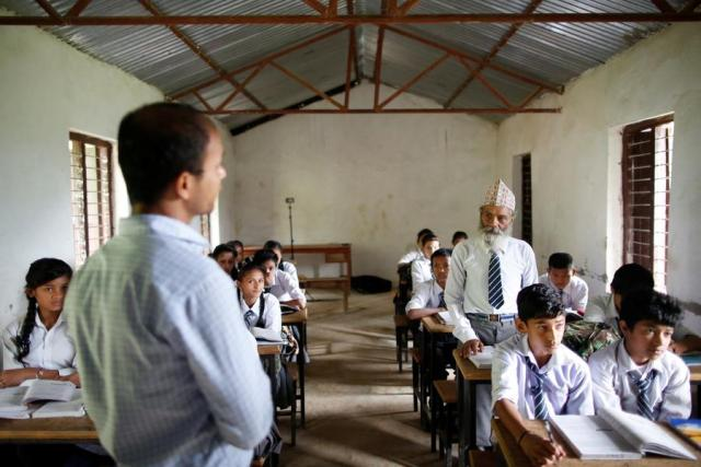 """Durga Kami, 68, who is studying in tenth grade at Shree Kala Bhairab Higher Secondary School, answers a question from his teacher as he attends a class in Syangja, Nepal, June 5, 2016.  REUTERS/Navesh Chitrakar. SEARCH """"DURGA KAMI"""" FOR THIS STORY. SEARCH """"THE WIDER IMAGE"""" FOR ALL STORIES"""