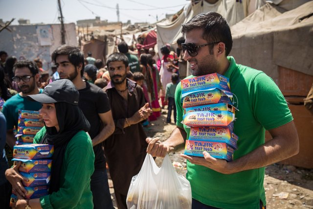 Each household is handed one meal for the family and a box of snacks for the children.