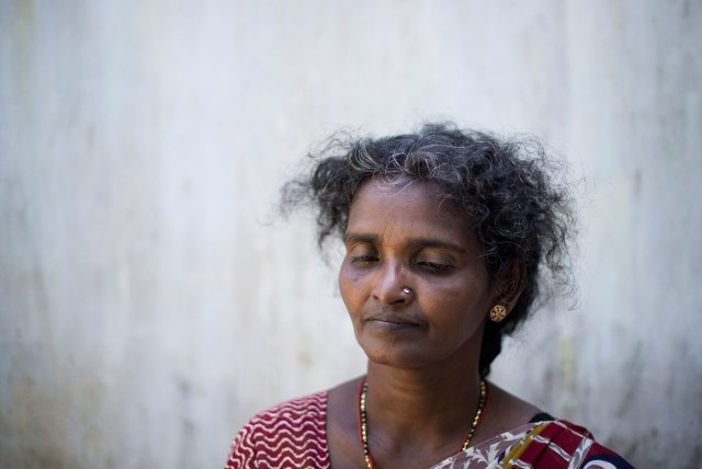 'In the last weeks of the war, my family had been dispersed, but on May 14, 2009, we all managed to get together in the 'safe zone' the army had established in Mullivaikal. They said civilians wouldn't be harmed there, so we found shelter in a small house ... We were happy to be together at last. But that same night, the building was shelled ... My husband was lying on the ground and, when I turned him around, I saw his chest open. He was dead. Next to him was my oldest daughter. She was holding her intestines in her hands, sure that she was going to die,' remembers Balasubramaniam Annaludchumy, who lost five members of her family that night.