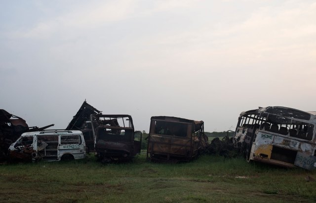Scenes of death and destruction remain as though frozen in time in parts of the north: Masses of twisted metal, hit by bullets and shells, line the sides of roads.