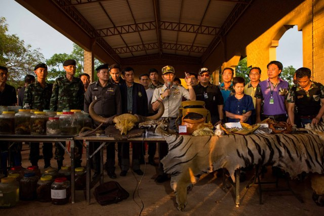DNP officials present evidence confiscated from the temple grounds and monk quarters in a press conference.