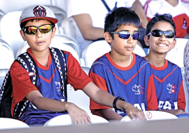 Nepal cricket fans watch their team's play against MMC at the Lord's cricket ground in London, on Tuesday, July 19, 2016.