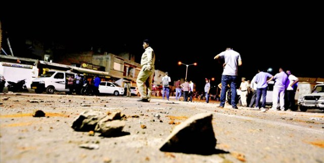 Ahmedabad: Police patrolling streets after a communal violence broke out in Juhapura area of Ahmedabad on Thursday night. PTI Photo (PTI6_24_2016_000117B)