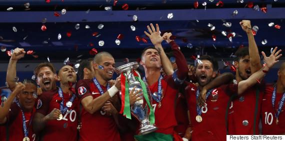 Football Soccer - Portugal v France - EURO 2016 - Final - Stade de France, Saint-Denis near Paris, France - 10/7/16 Portugal's Cristiano Ronaldo celebrates with team mates and the trophy after winning Euro 2016  REUTERS/Kai Pfaffenbach Livepic