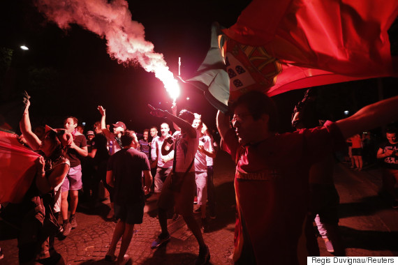 Portugal fans react on the Champs-Elysees after their team beat France in the Portugal v France EURO 2016 final soccer match in Paris, France, July 10, 2016.      REUTERS/Regis Duvignau