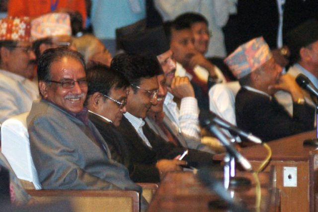 CPN Maoist Centre Chairman Pushpa Kamal Dahal (left) along with lawmakers of his party react to the Prime Minister KP Sharma Oli's speech at the Parliament, on Sunday, July 24, 2016.