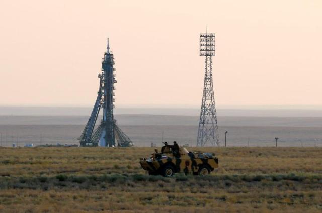 Policemen ride an armoured vehicle in front of the Soyuz MS spacecraft shortly before its launch with the International Space Station (ISS) crew of Kate Rubins of the U.S., Anatoly Ivanishin of Russia and Takuya Onishi of Japan at the Baikonur cosmodrome, Kazakhstan, July 7, 2016. REUTERS/Shamil Zhumatov