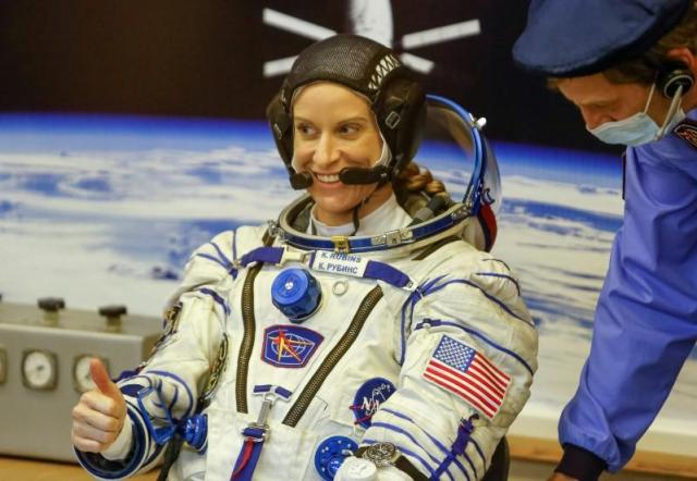The International Space Station (ISS) crew member Kate Rubins of the U.S. gives thumb up after donning space suits at the Baikonur cosmodrome, Kazakhstan, July 7, 2016. REUTERS/Shamil Zhumatov