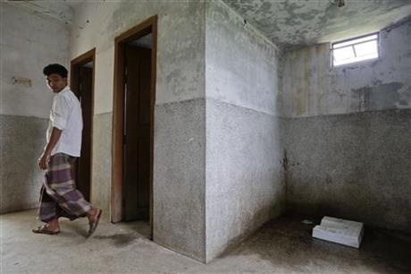 In this May 30, 2016 photo, a Bangladeshi man walks inside a public toilet in Bormi village, near Dhaka, Bangladesh. Through a dogged campaign to build toilets and educate Bangladeshis about the dangers of open defecation, the densely populated South Asian nation has managed to reduce the number of people who defecate in the open to just 1 percent of the 166 million population, according to the government, down from 43 percent in 2003.