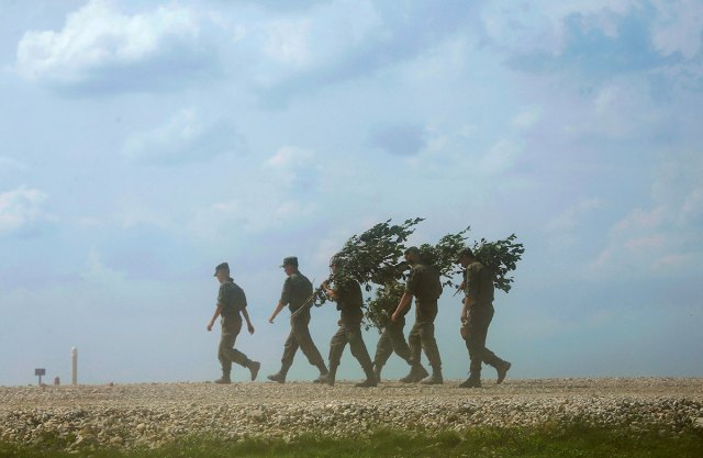 Servicemen walk during a competition of the International Army Games 2016 at a range in the settlement of Alabino outside of Moscow.