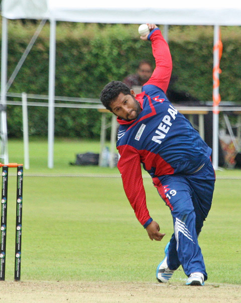 Nepal's Basanta Regmi bowls against the Netherlands during the ICC World Cricket League Championship at Amsteelveen, on Saturday, August 13, 2016. Courtesy: Cricket Europe