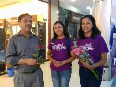 Black lotus group selling off their roses at the City centre.