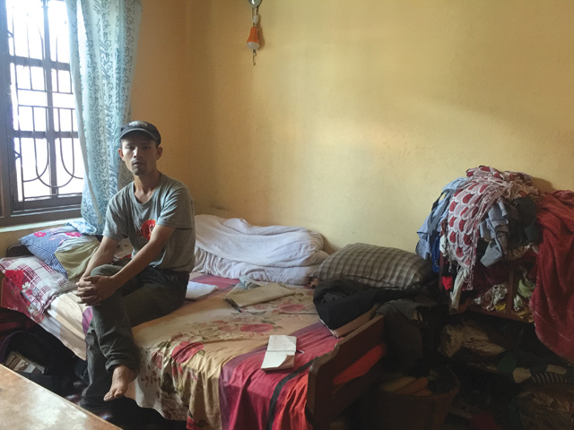 Rakesh Tamang, 33, in his rented room in Gongabu. He became jobless after his taxi was burnt by Maoists enforcing a strike last year. Both Khatri and Tamang are deep in debt and have received no compensation.