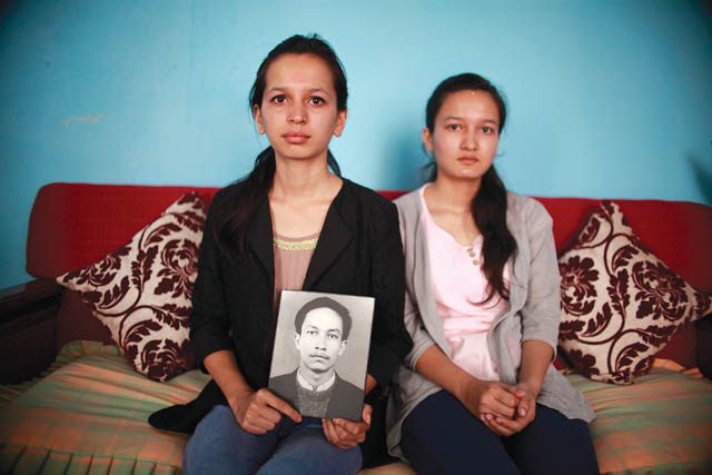Nutan Thapa with her younger sister Nisha Thapa at their home in Kathmandu this week.
