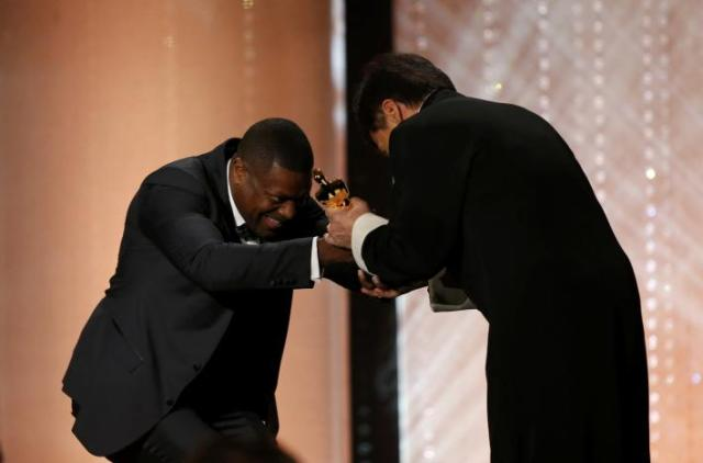 Actor Chris Tucker present Jackie Chan (R) with his Honorary Award at the 8th Annual Governors Awards in Los Angeles, California, U.S.
