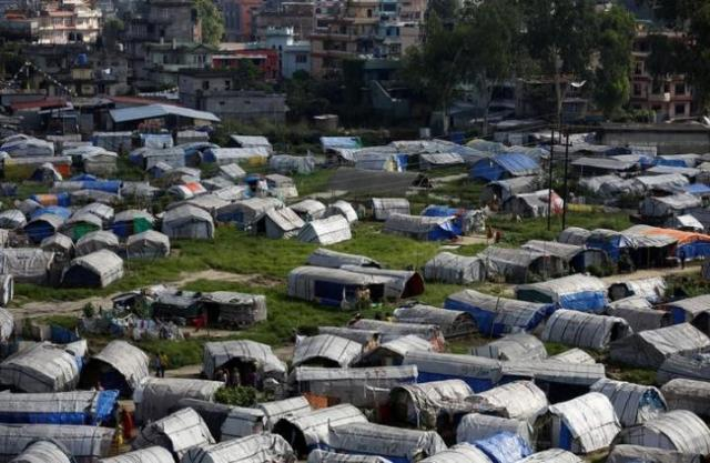 Makeshift shelters are pictured inside the displacement camps for earthquake victims at Chuchepati in Kathmandu, Nepal, September 19, 2016. Thomson Reuters Foundation/Navesh Chitrakar
