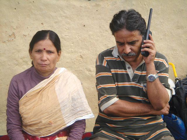 Prachanda speaks on a satellite phone with Sita alongside in Dang in 2005. The phones and pre-paid SIMs were sourced from Thailand by the party's procurement chief, Bhakti Prasad Pandey, who died of lung cancer two weeks ago.