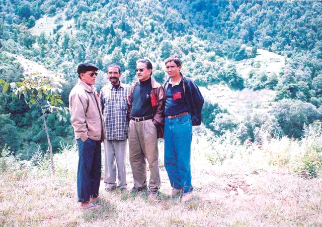 Pushpa Kamal Dahal with Ram Karki in Rukum after the Chunbang meeting in 2005. Karki is currently Minister of Information and Communication.