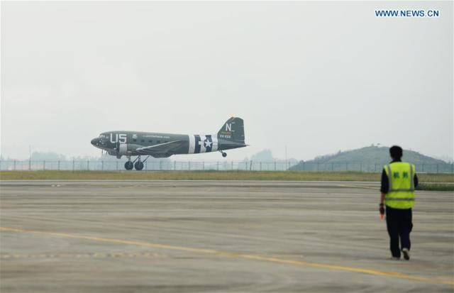 """A C-47 aircraft, contributed by the Flying Tiger Historical Organization in the United States, lands at the Liangjiang airport in Guilin, south China's Guangxi Zhuang Autonomous Region, Nov. 19, 2016. The plane used in the Australian battleground during World War II reached south China's Guilin, after it repeated a flight of the dangerous """"hump route"""" over the Himalayas, a route flown by the famous U.S. Flying Tigers. It will be permanently displayed at the Flying Tigers Heritage Park in Guilin."""