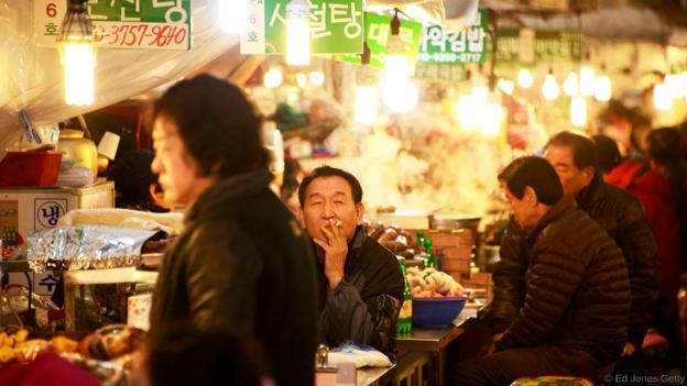 Enjoying one of the many quirky eateries in Seoul (Credit: Ed Jones/Getty)