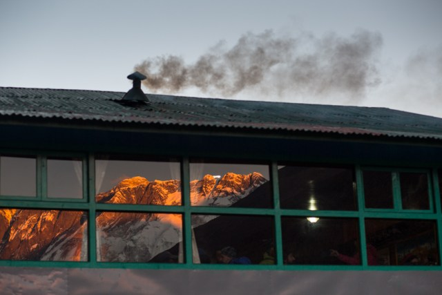 Smoke emitted from a hotel in Debuche as the sun sets over Mount Everest. Recent studies show that black carbon from such smoke is causing faster retreat of the glaciers in Himalaya region.