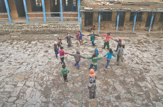 Children playing the classic 'Euta Sathi Jungle Ma' during recess.
