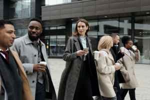 coworkers walking as they take a coffee break.