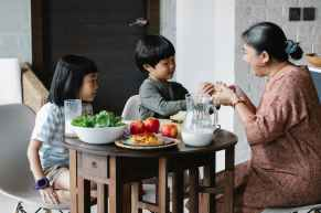 grandmother giving sandwich to asian grandson. This is an easy lunch idea for kids.
