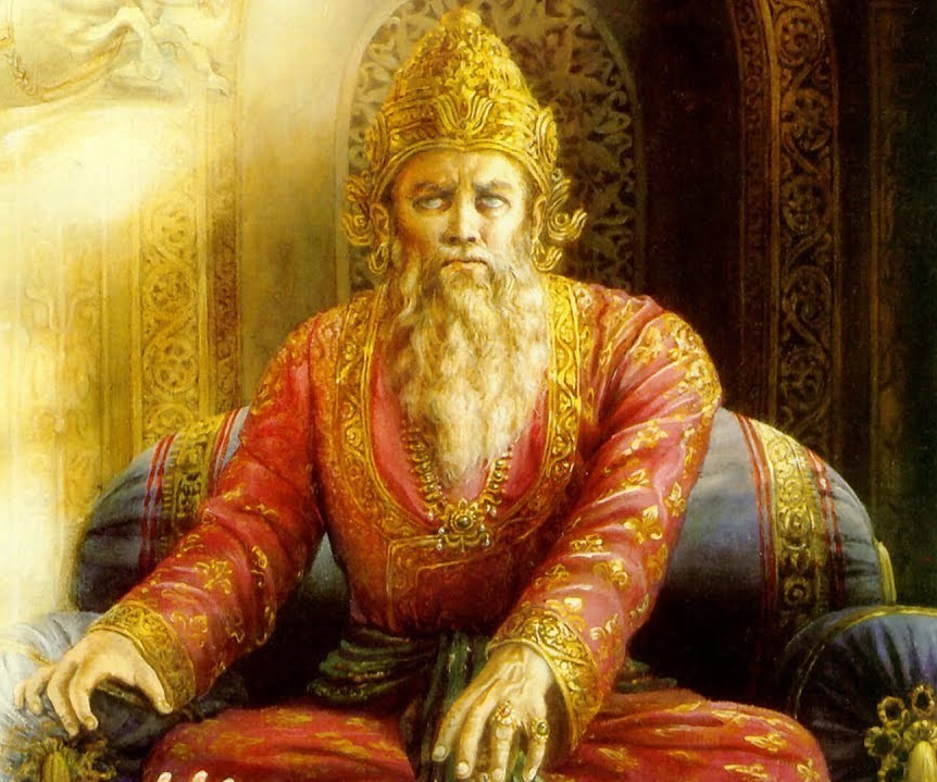 The blind king Dhritarashtra sitting on a royal chair in his palace