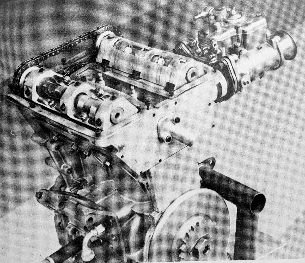 The chain-driven DOHC cylinder head, with central spark plugs and 4 valves per cylinder (Cycle World)