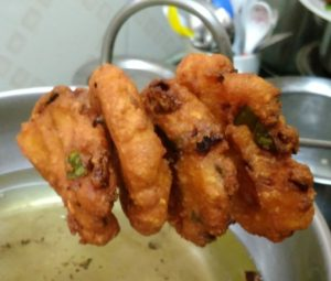 Fry the batter for Tapioca fritters/kelangu vada recipe