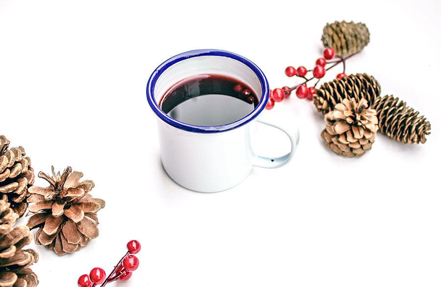 cup of coffee with pinecones