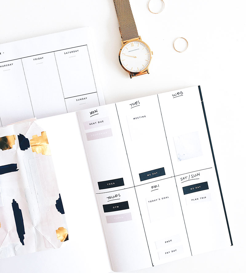 planner and watch to plan your goals