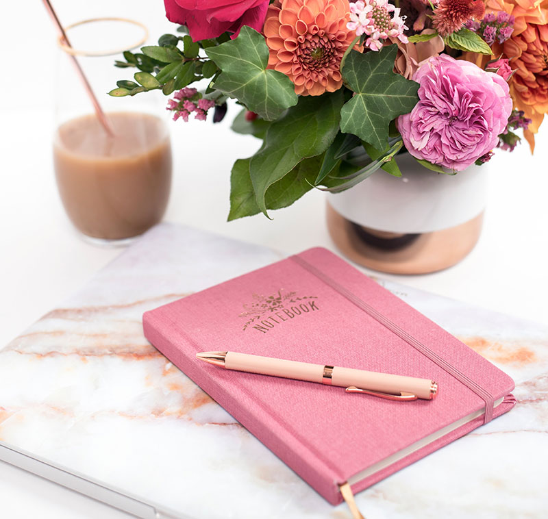 planner with flowers and coffee