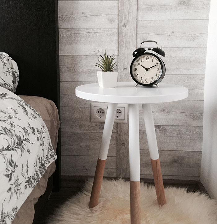 clock on a bed-side stand