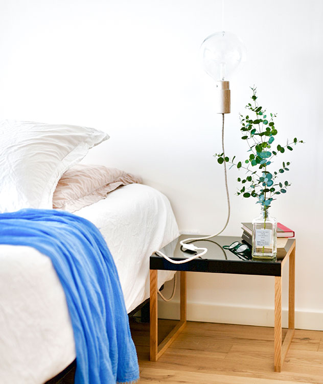 bedside table with a blanket