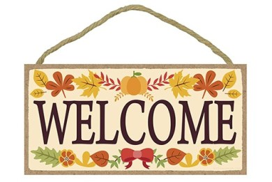 welcome sign with fall leaves