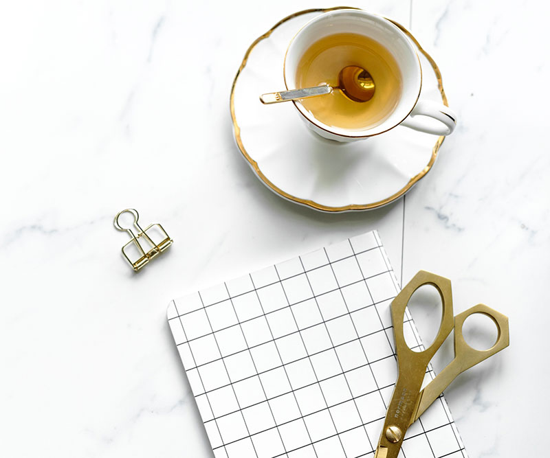 tea with a notepad and scissors