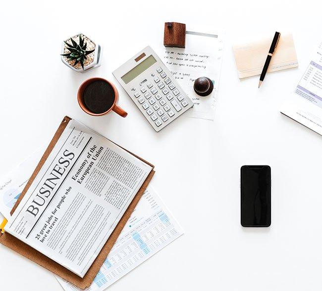 business newspaper and calculator
