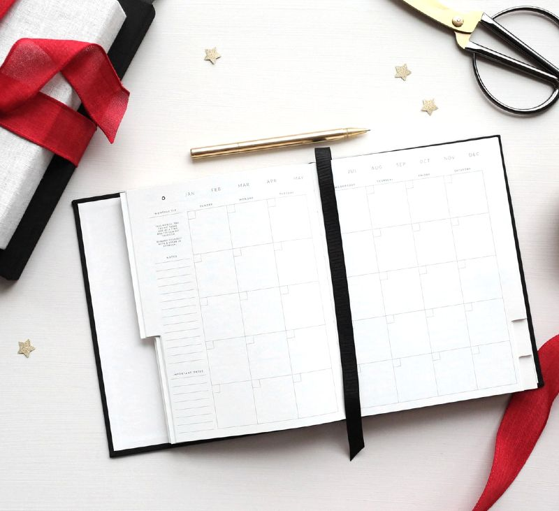 planner with red ribbons