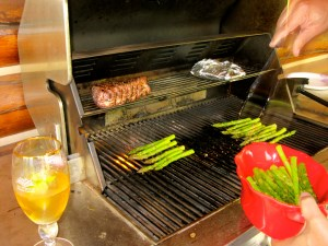 The Grill-Meister at work. He does the asparagus last and lets the meat rest.