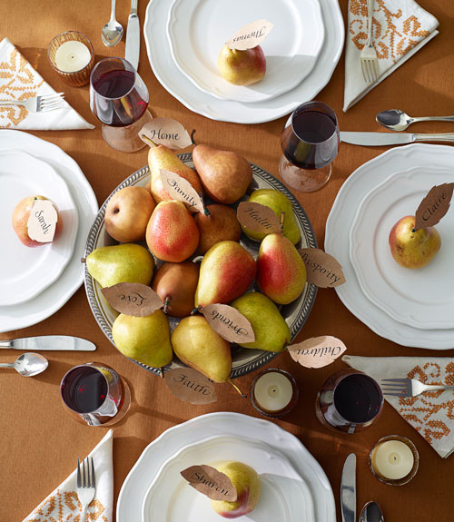 """The pears in this centerpiece have paper """"thankful for"""" leaves (photo from Good Housekeeping)."""