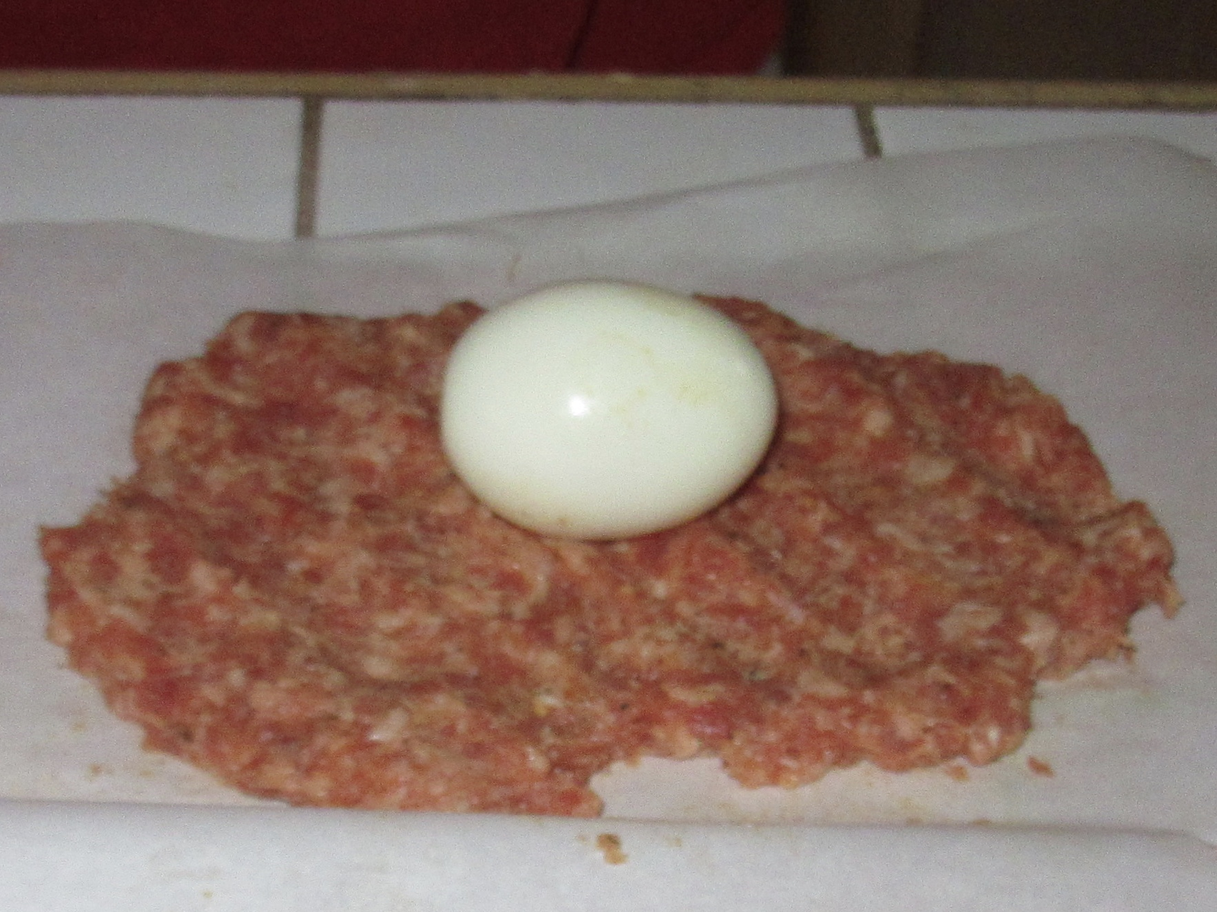 Place each egg on a sausage patty.