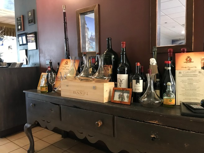 Oil, vinegar and wine rests on a beautiful old buffet at Celestino