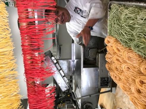 Demonstrating the pasta machine at Celestino
