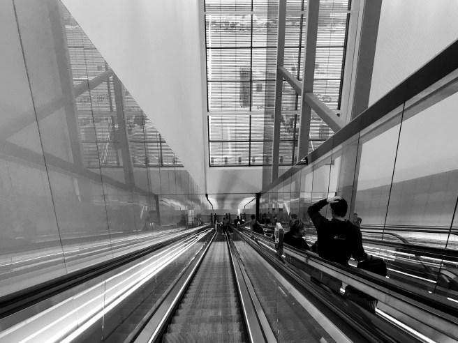 All angles, a long way down an escalator at Heathrow Terminal 4